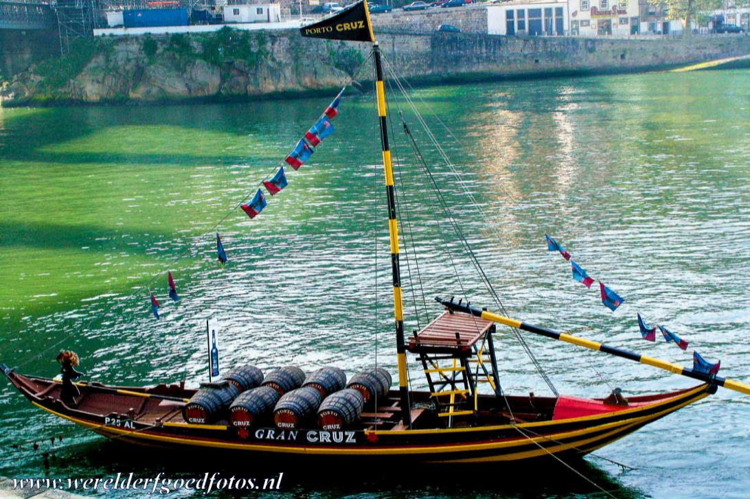 Historic Centre of Porto - Historic Centre of Porto: A traditional Rabelo boat on the river Douro, the River of Gold. The wooden Rabelo boats were used to transport the...